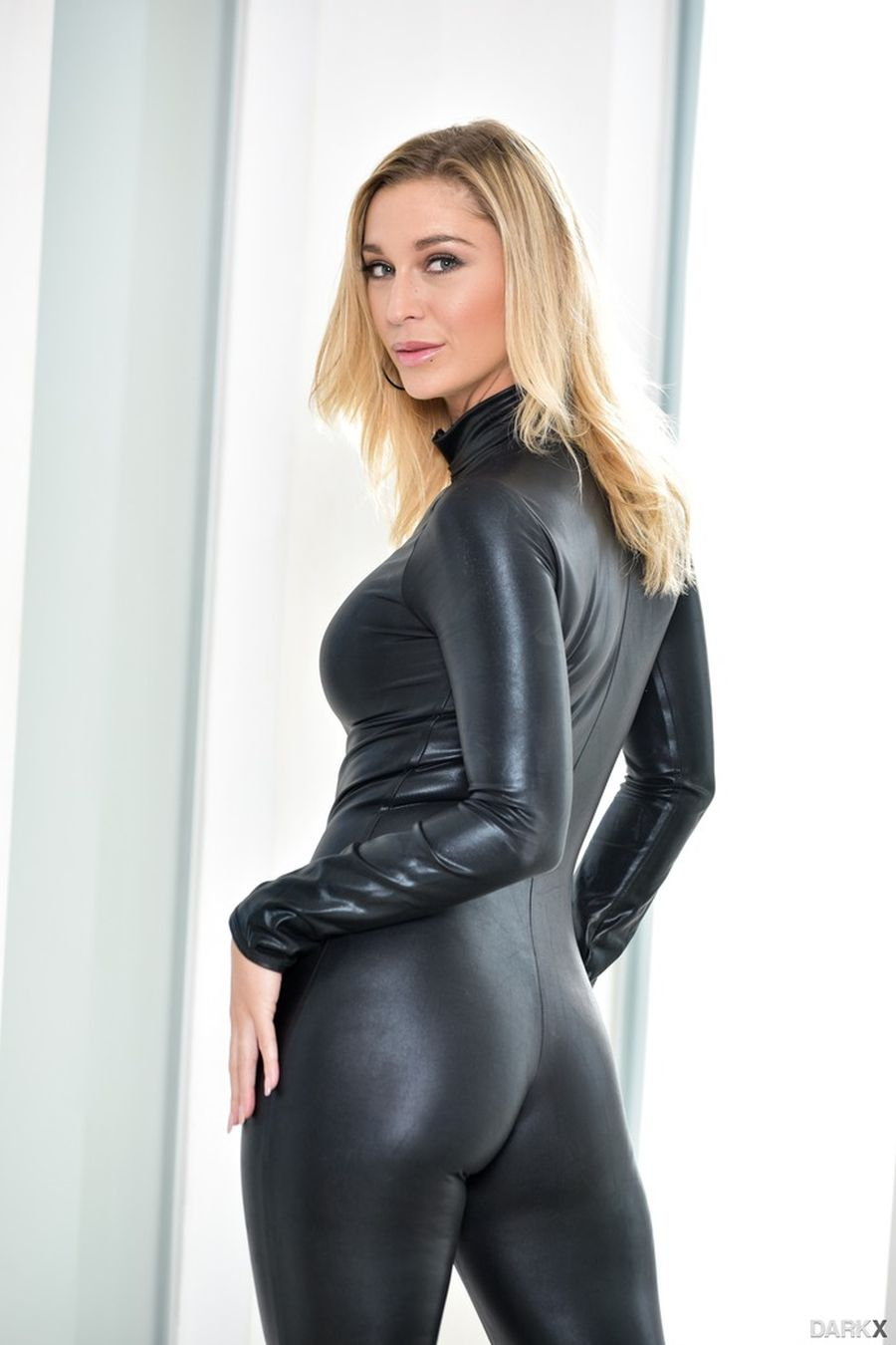 Strakke latex bodysuit