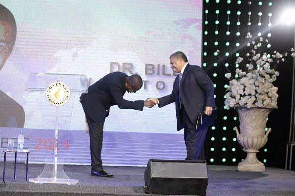 Pastor Poju welcoming Dr Bill Winston at the evening session
