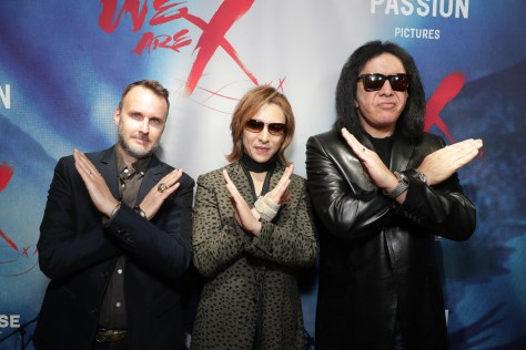 """Director Stephen Kijak, Yoshiki and Gene Simmons seen at The Los Angeles Premiere """"We Are X"""" on Monday, October 03, 2016, in Los Angeles, CA. (Photo by Eric Charbonneau/Invision for Drafthouse Films/AP Images)"""
