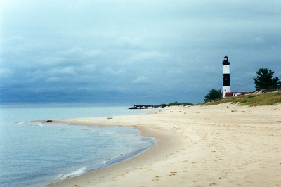 coastal view of ocean and lighthouse in ludington mi