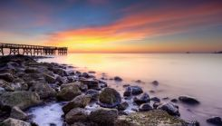 wooden pier on the Chesapeake Bay at sunrise