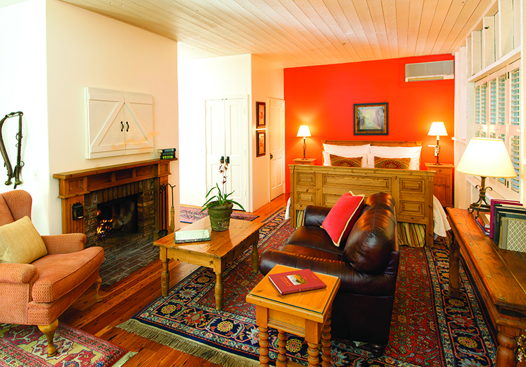 beautiful living area, colorful orange paint and vibrant decor