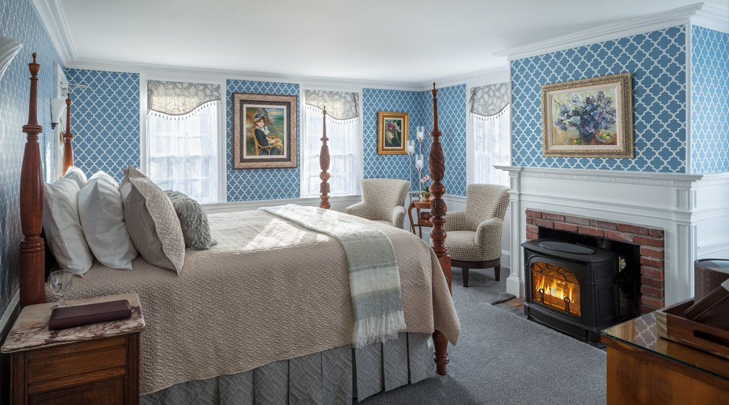captain lord mansion bedroom with blue accents and four poster bed