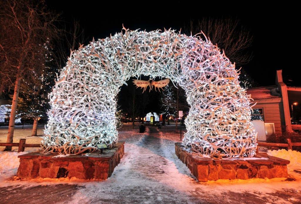 Large elk antler arches curve over Jackson Hole's square's four corner entrances. The antlers have been there since the early 1960s, and new arches are currently assembled to replace them.