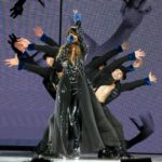 Selena Gomez dances with dancers dressed in zoos suits on the Revival Tour at the Staples Center in Los Angeles, CA