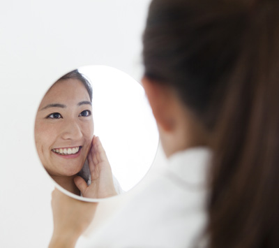 Women are laughing looking in the mirror