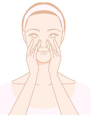 顔のツボを押す女性の画像