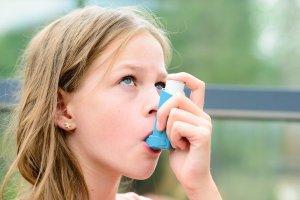 bigstock-pretty-girl-using-asthma-inhal-119293265-min