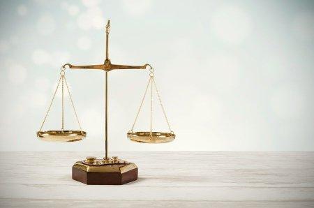bigstock-law-scale-justice-symbol-153864329-min