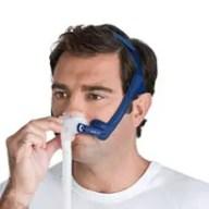 man wearing cpap nasal pillow