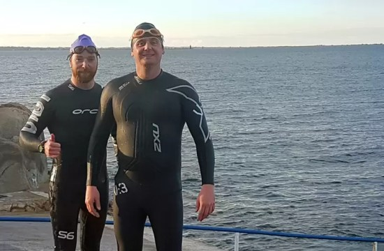 SWIMMING FOR CHARITY THROUGH SHARK-INFESTED WATERS