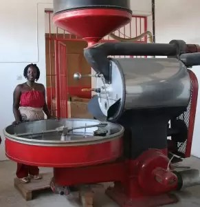 Diane Nsengiyumba, proprietor of 'Shambo Coffee' in Burundi is pictured in her coffee roasting plant in Burundi. With support from Traidlinks and Trademark East Africa, Diane is selling her roasted coffee to markets in Democratic Republic of Congo and Tanzania. Main Image: Bernard O'Connell of Traidlinks pictured with African women entrepreneurs from Burundi on a trade mission to Democratic Republic of Congo in September, 2016.