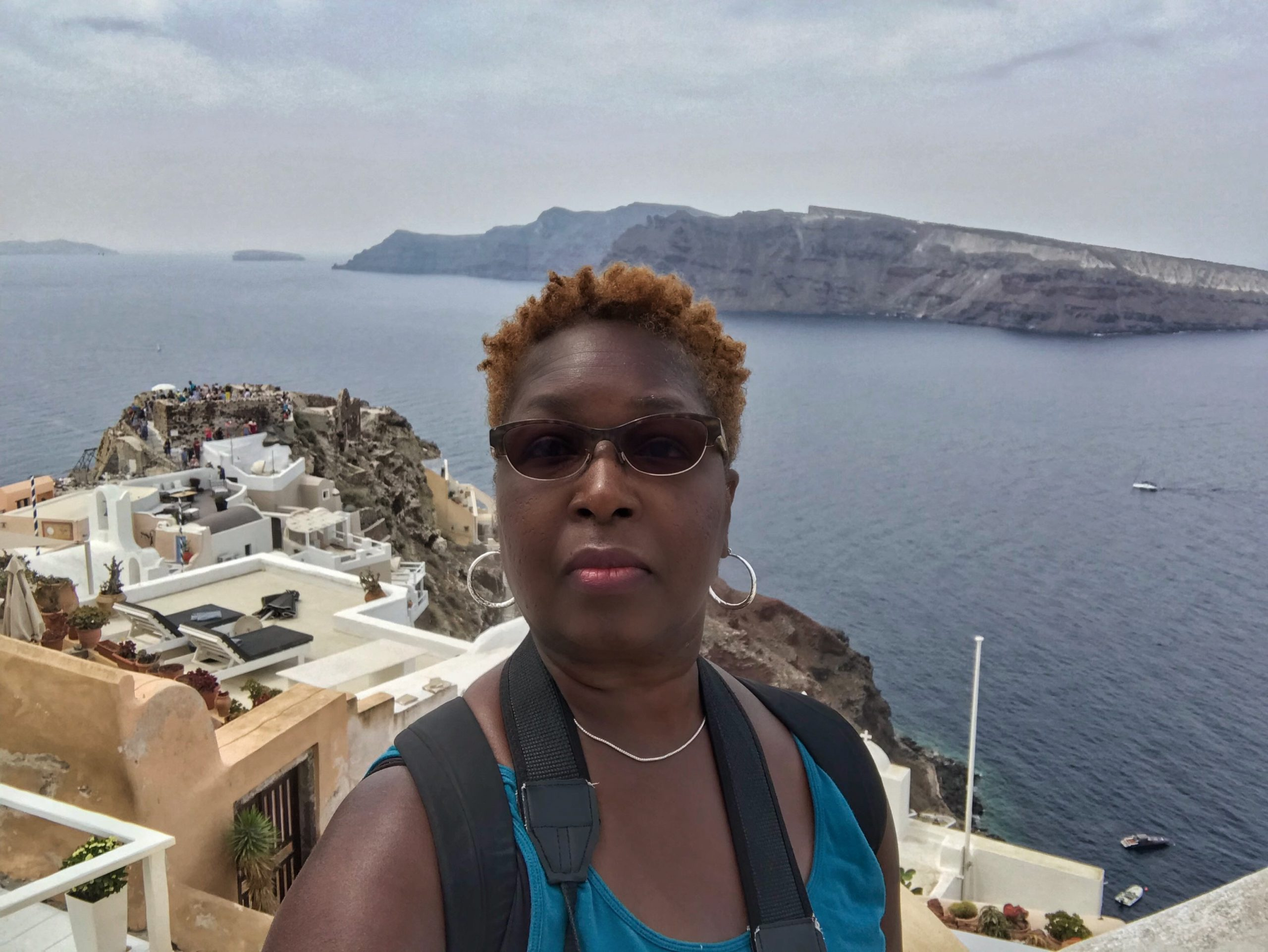 Danielle Lewis, owner of SelfishMe Travel LLC, in Oia, Santorini, Greece - image taken with an iPhone 7