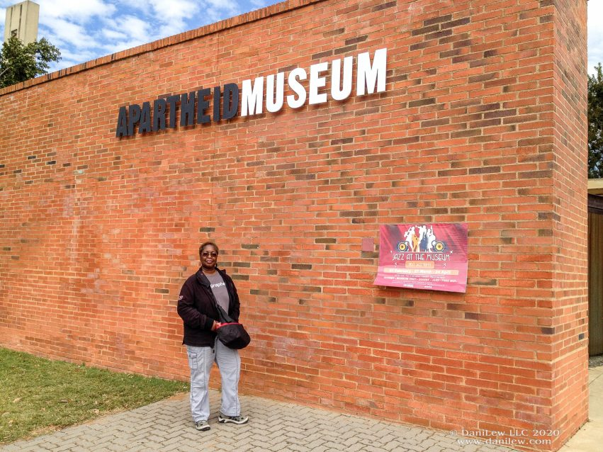 DaniLew at the Apartheid Museum in South Africa on the Slow Traveling Soul Sister blog post