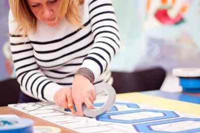 Concentrated on gluing- Tape Art Workshop by Ostap