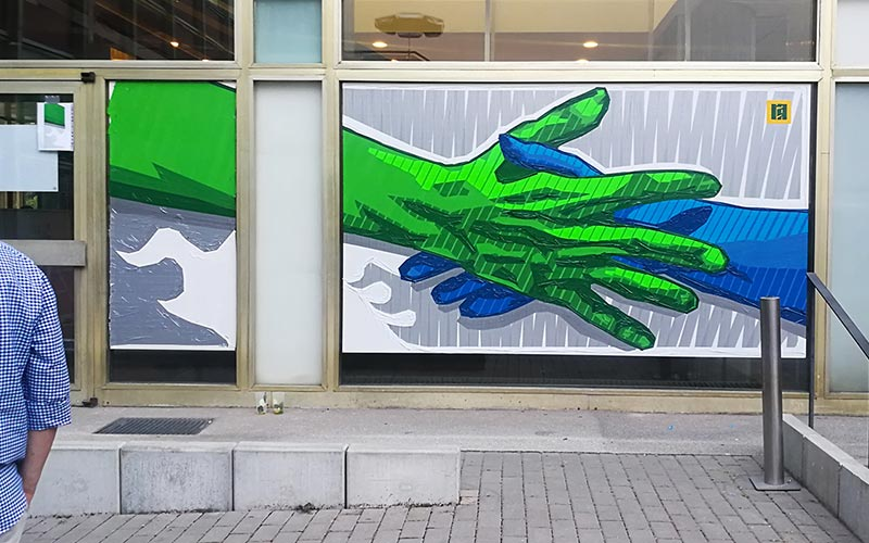 Reaching out a hand, as a welcome symbol- Finished artwork 2 x 5 meters in size