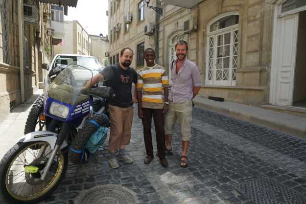 With Silk Road motorcyclist, Baptiste, and Babatunde at Baku Old City hostel