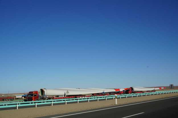 Wind turbine blades were often seen on the move in Xinjiang, which has windfarms the size of a small English county.