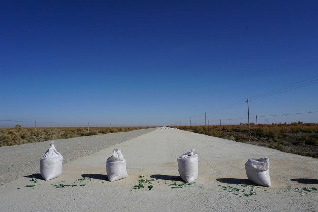 A dirty trick to prevent cycling on the new road deck, approaching Dunhuang, Gansu.