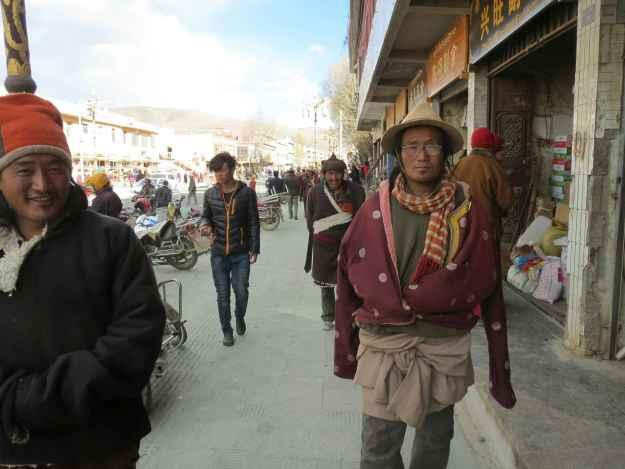 For Tibetan men, the cowboy look is de rigeur.