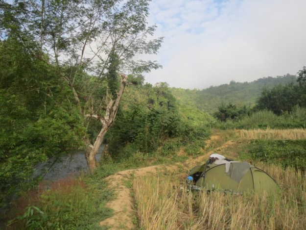 Riverside camping in Laos, great to have a bath after such a sweaty, dusty day on the road.