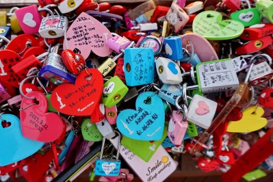 Sweethearts' love padlocks on railings at Namsan Tower, Seoul.