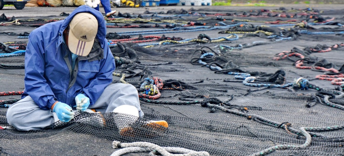Fishermen fixing their nets at Muroto Cape, Shikoku