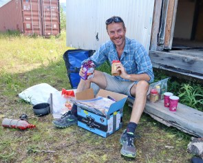 Happy camper, opening my food parcel at Coldfoot Camp. Photo: J.Griffin