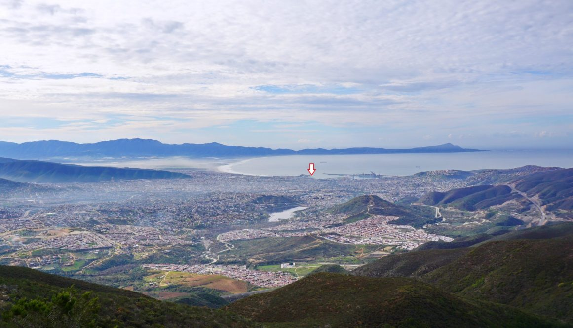 View from Cerro Miracielo (hill to see the sky) over Ensenada. Ensenada means cove. Arrow shows position of the boat.