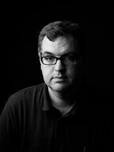 headshot of Tim Lewis