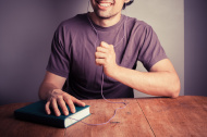 young-man-listening-to-audio-book
