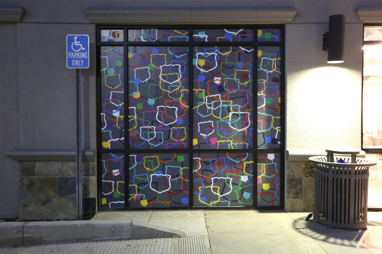 mod pizza window stencil installation art spraypaint branding graffiti usa klughaus gallery selfuno