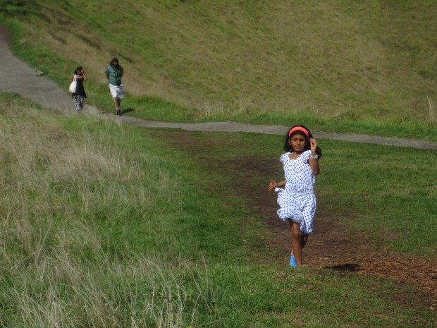 Sister running down Mount Eden