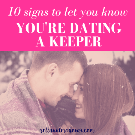 """girl and guy stare at each other and smile as they share a winter blanket outside in snowy weather with pink overlay and white text that reads, """"10 Signs to Let You Know You're Dating a Keeper"""""""