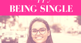 """girl with glasses smiles while standing in front of a city street with pink overlay and white text that reads, """"5 Ways to Be Happy Being Single"""""""