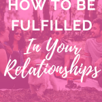 "group of friends laughing and sitting together on the ground of a park scene with pink overlay with white text that reads, ""How to Be Fulfilled in Your Relationships"""