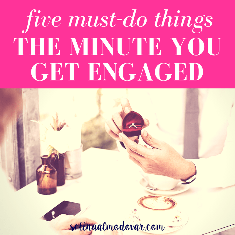 """hands of a man holding a red velvet that contains a diamond while sitting across from a woman at a restaurant dinner table with pink overlay and white text that reads, """"Five Must-Do Things the Minute You Get Engaged"""""""