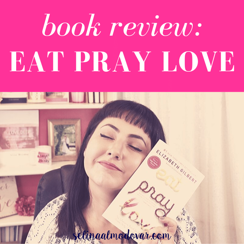 """Selina Almodovar smiling with her eyes closed while holding up the book, """"Eat Pray Love"""" to the side of her face sitting in front of a bookshelf with pink overlay and white text that reads, """"Book Review: Eat Pray Love"""""""