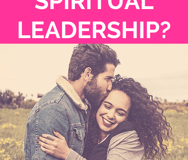 """woman with curly hair embraces man with facial hair who is leaning in kissing her head while embracing each other in the wind of a green pasture setting with pink overlay and white text that reads, """"Can Your Man Step Up His Spiritual Leadership?"""""""