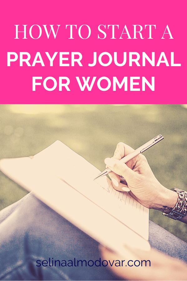 """woman's hand holding a pen writes in a journal that lays on her knees with pink overlay and white text that reads, """"How To Start A Prayer Journal For Women"""""""