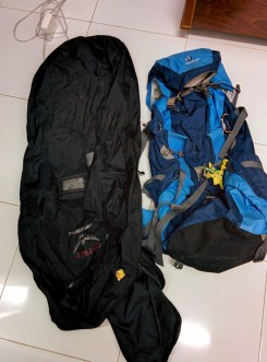 """1 backpacking pack: I got a 60 liter bag which is smaller than others but I needed a small enough bag that would fit with my 5'0"""" frams. (http://www.rei.com/product/795606/deuter-act-lite-60-10-sl-pack-womens?partner=cse_PLA&mr:trackingCode=9AA9A1E3-F810-DF11-BAE3-0019B9C043EB&mr:referralID=NA) 1 backpacking backpack airport carrier. This thing is super useful. You just stick your backpacking pack in there and you won't have to worry about securing your straps. It also protects your bag during travel. Also, you can throw extra things into this bag if everything won't fit in your bag."""