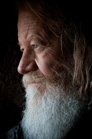 photo of Older man with long hair and beard