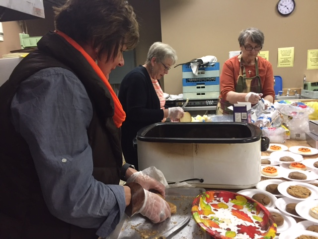 photo of Halloween supper volunteers working
