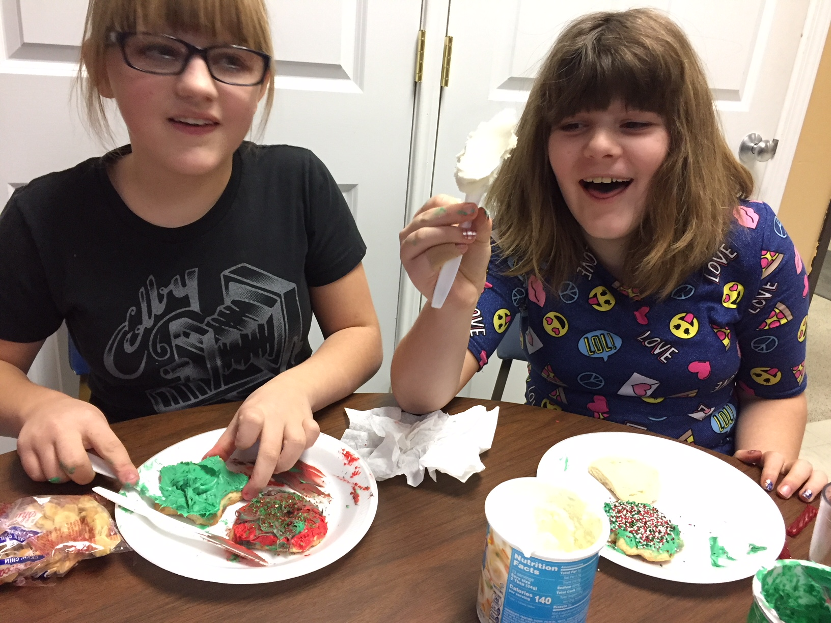 photo of after-school program kids decorating cookies