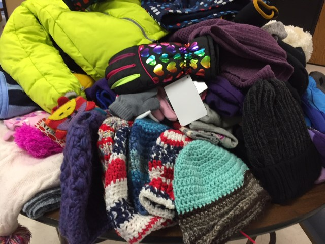 photo of mitten and hat donation from NHS students