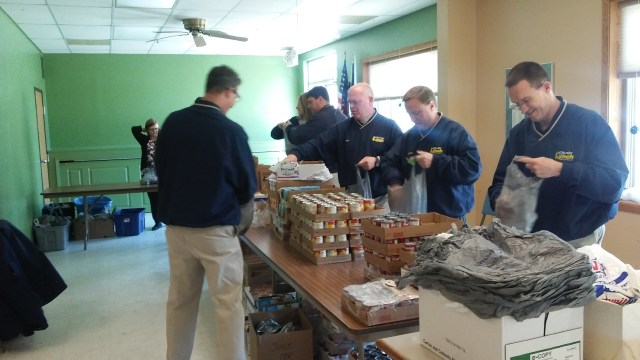 photo of Lynch volunteers packing kids' food bags