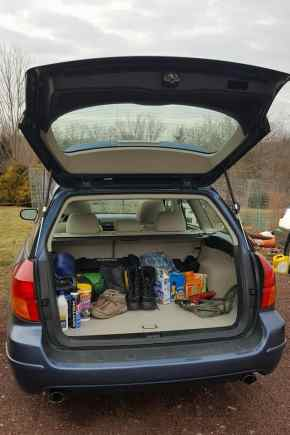 Car with open trunk and supplies