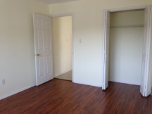 Bedoom with new pergo flooring and nice size closet