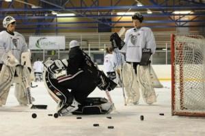 Goalie Coach teaching a goalie drill