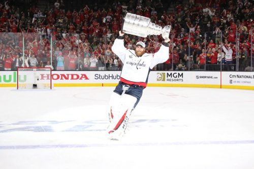 Braden Holtby hoisting the Stanley Cup